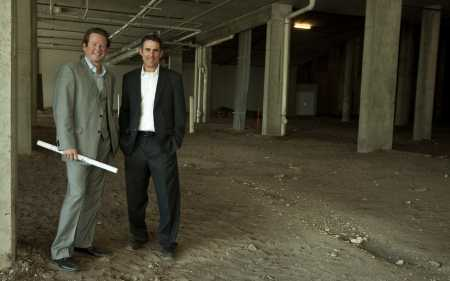 Drew Nederpelt, left, and partner Randy Gruber stand in their prospective TV studios for the Health & Wellness Channel.
